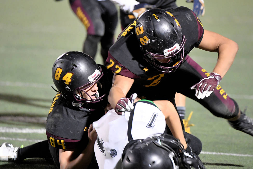 Peter Davis/Special to the Pahrump Valley Times Andrew Avena, left and Anthony Peralta tackle V ...