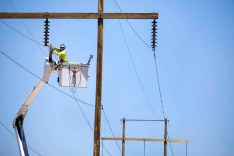 Valley Electric Association Inc. file Crews from Valley Electric Association moves three 75-foo ...