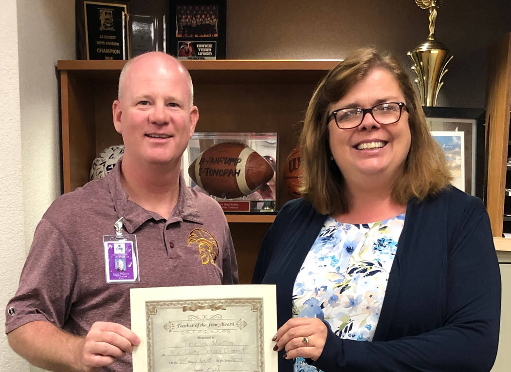 Special to the Pahrump Valley Times Jason Odegard (left), an assistant principal at Pahrump Va ...