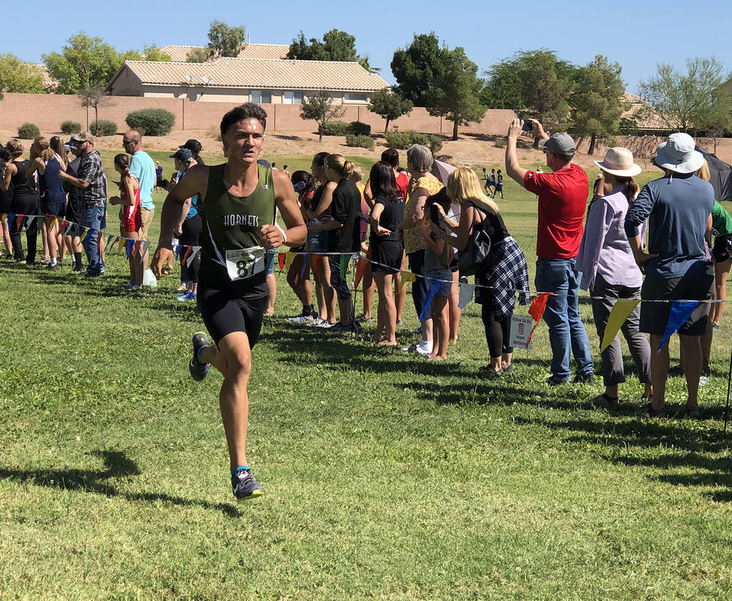 Tom Rysinski/Pahrump Valley Times Beatty senior Jose Granados nears the finish line of the juni ...