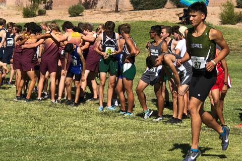 Tom Rysinski/Pahrump Valley Times Pahrump Valley High School cross country runners go into a pr ...