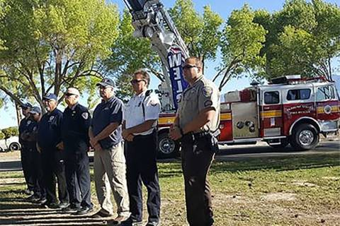 Horace Langford Jr./Pahrump Valley Times Local first responders stand before Pahrump Valley Fir ...