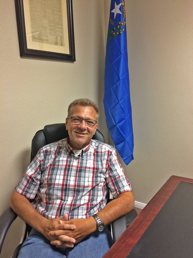 Robin Hebrock/Pahrump Valley Times Dr. Joseph Bradley poses for a photo in his Pahrump office, ...