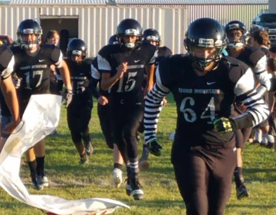 Special to Times-Bonanza & Goldfield News Round Mountain High School football players take the ...