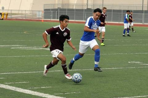 Horace Langford Jr./Pahrump Valley Times Sophomore Christopher Vega makes a run for the Pahrump ...