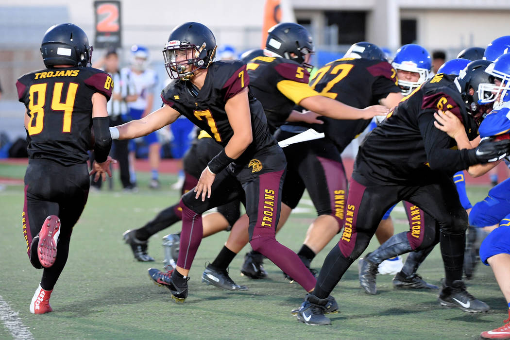 Peter Davis/Special to the Pahrump Valley Times Junior quarterback Dylan Wright hands off to ju ...