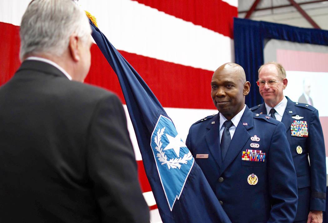 Senior Airman Baylee Belanger/Nevada National Guard Brig. Gen. Ondra Berry, center, receives c ...