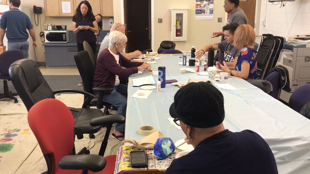 Jeffrey Meehan/Pahrump Valley Times Members from AmeriCorps Vista, the community and others pai ...