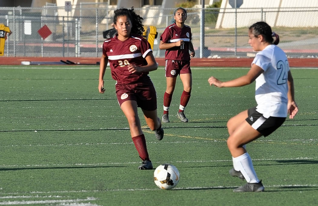 Horace Langford Jr./Pahrump Valley Times Pahrump Valley freshman Jessica Garcia moves in on a V ...
