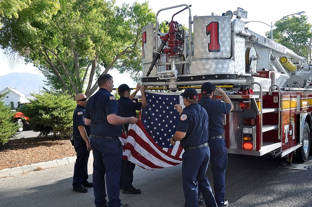 Horace Langford Jr./Pahrump Valley Times Pahrump firefighters and EMT's prepare to raise the A ...