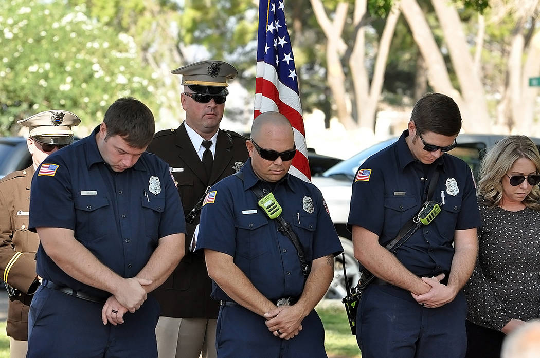 Horace Langford Jr./Pahrump Valley Times Pahrump first responders take a moment to reflect upo ...