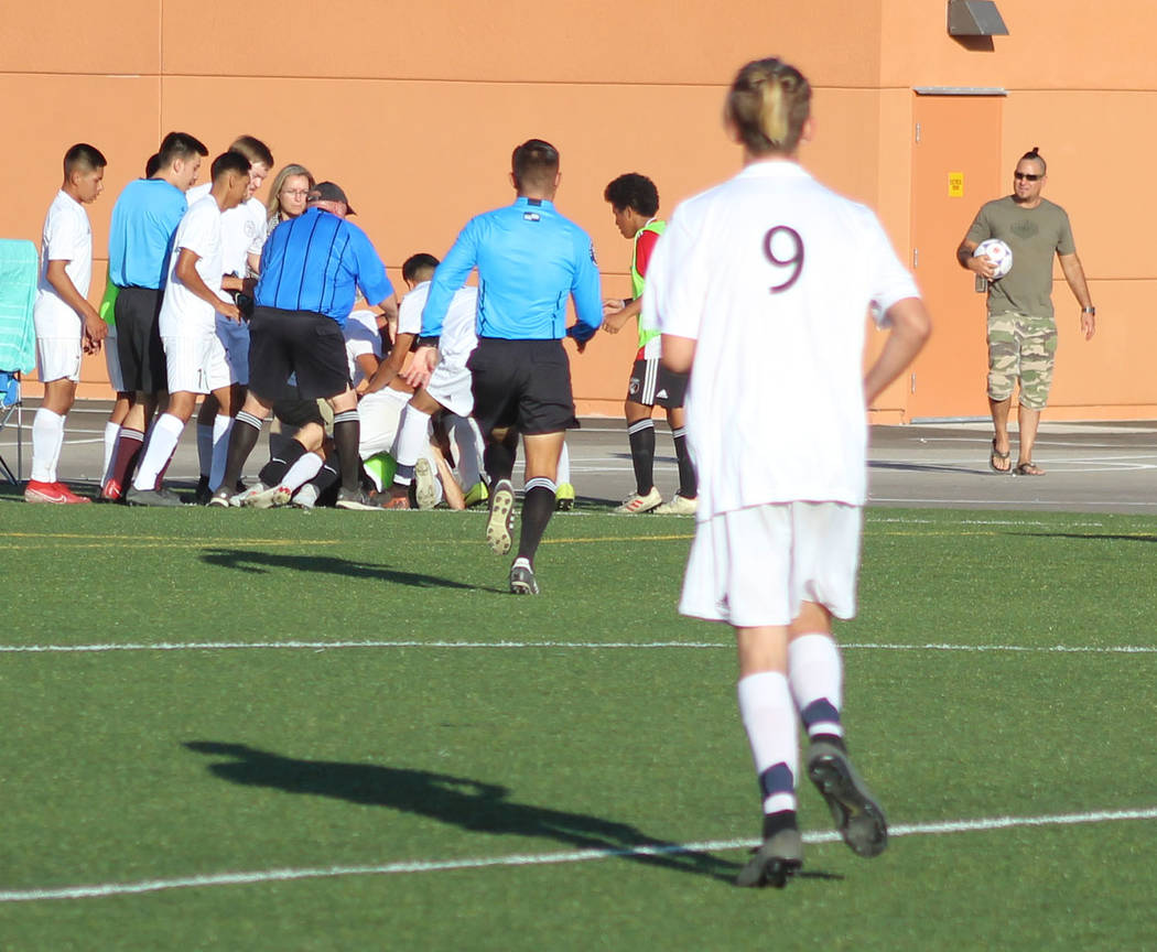 Tom Rysinski/Pahrump Valley Times Players and officials rush to break up an altercation during ...