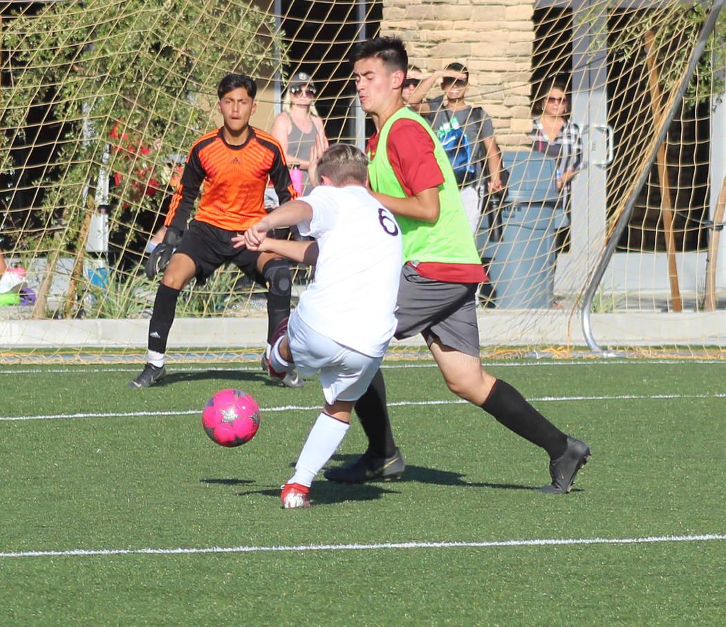 Tom Rysinski/Pahrump Valley Times Sophomore Christian Mott sends one of his nine shots on goal ...