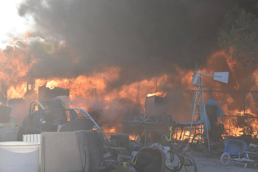 Special to the Pahrump Valley Times Pahrump fire crews were met with discharging ammunition, fi ...