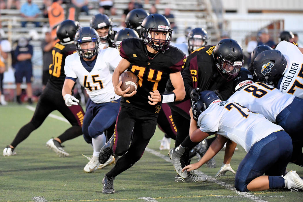 Peter Davis/Special to the Pahrump Valley Times Pahrump Valley junior Andrew Avena looks for ru ...