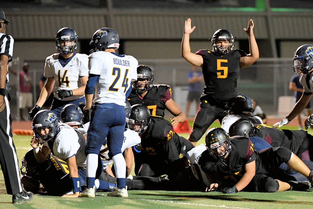 Peter Davis/Special to the Pahrump Valley Times Senior Kody Peugh signals for a touchdown on a ...