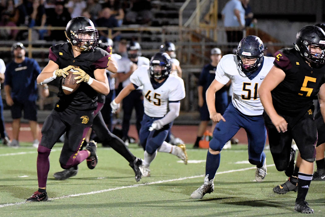 Peter Davis/Special to the Pahrump Valley Times Pahrump Valley junior Dylan Wright rolls out on ...