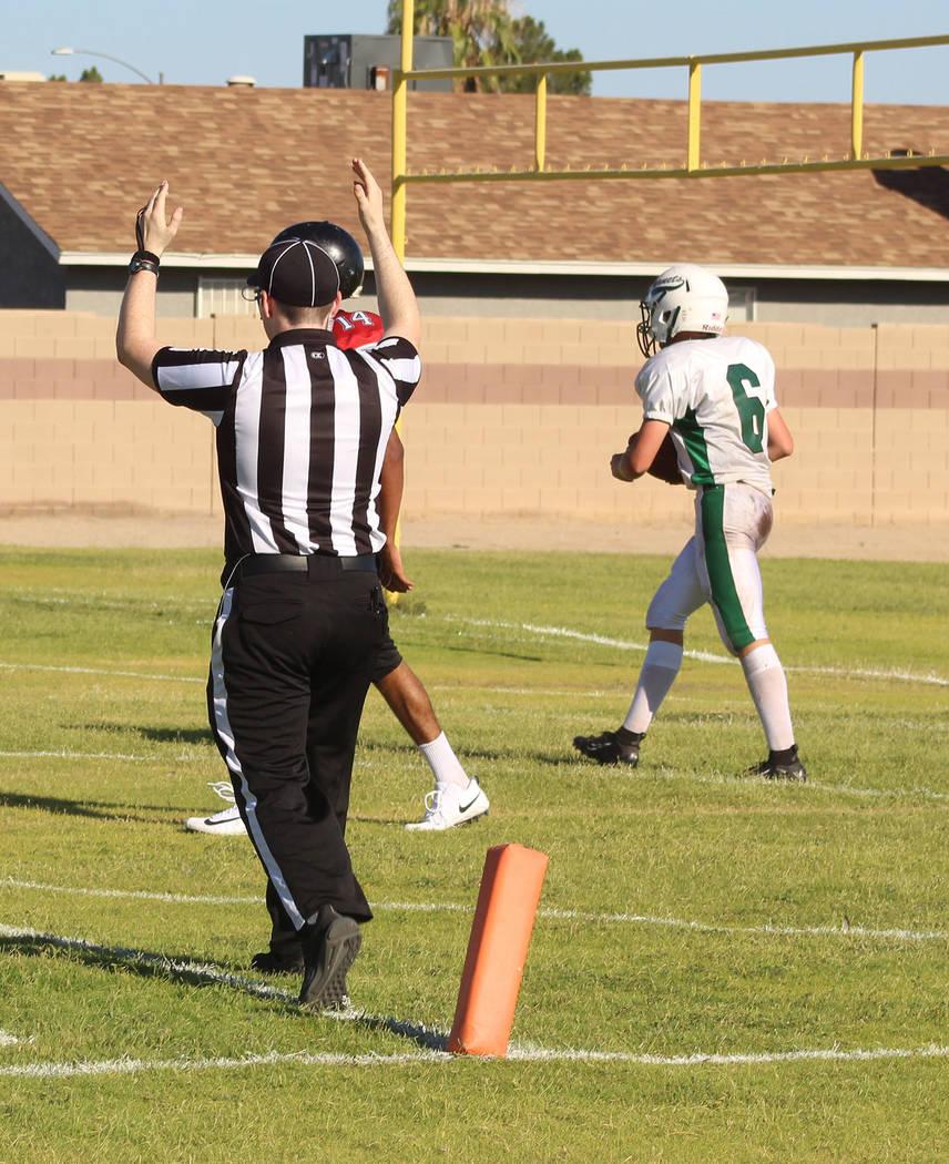 Tom Rysinski/Pahrump Valley Times Junior quarterback Brayden Lynn scores one of his three touch ...