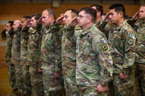 Soldiers with the Nevada Army Guard 3665th Explosive Ordnance Disposal Company salute during a ...