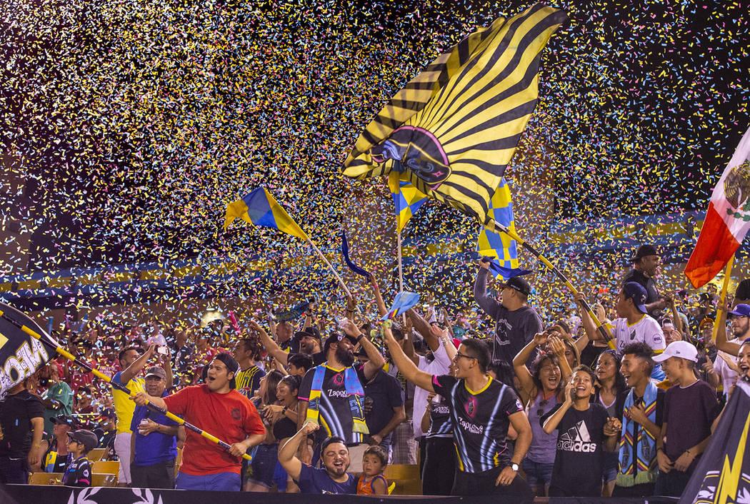 L.E. Baskow/Las Vegas Review-Journal Las Vegas Lights FC fans are bathed in confetti as the tea ...
