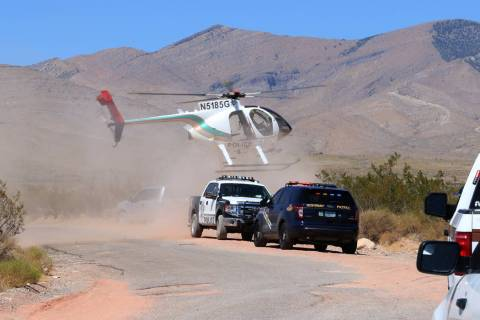 A Metropolitan Police Department helicopter lands near Goodsprings, southwest of Las Vegas, whe ...