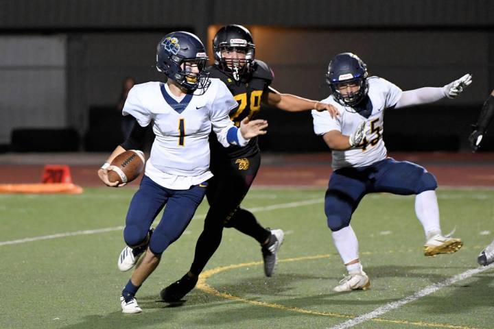 Peter Davis/Special to the Pahrump Valley Times Pahrump Valley junior Jalen Denton chases Bould ...