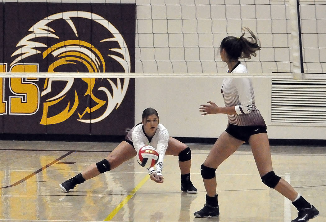 Horace Langford Jr./Pahrump Valley Times Pahrump Valley sophomore Tayla Wombaker reaches to set ...