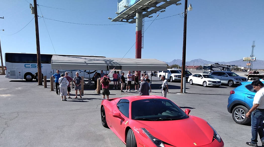 Selwyn Harris/Pahrump Valley Times Several dozen tourists, many from Europe, depart a tour bus ...