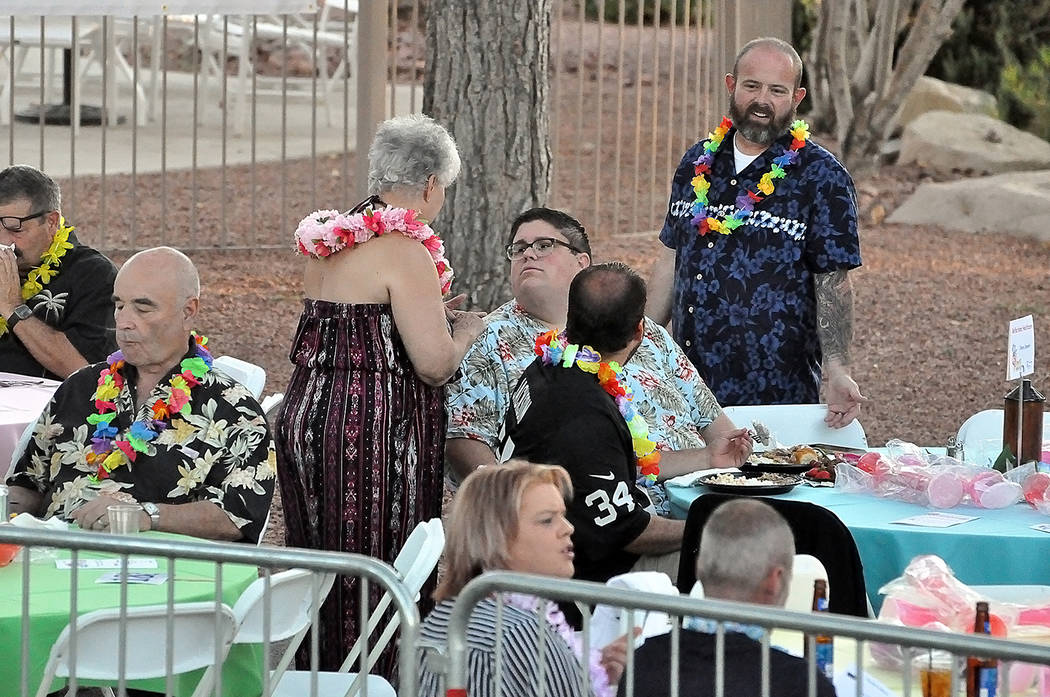 Horace Langford Jr./Pahrump Valley Times Guests at the 2019 CASA Luau are pictured sporting Ha ...