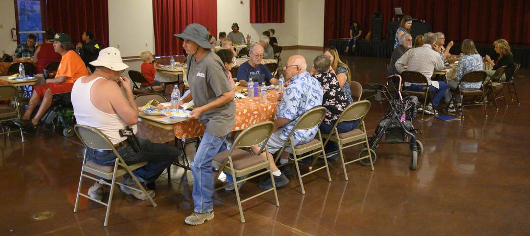 Richard Stephens/Special to the Pahrump Valley Times Residents sit at tables during the meet an ...