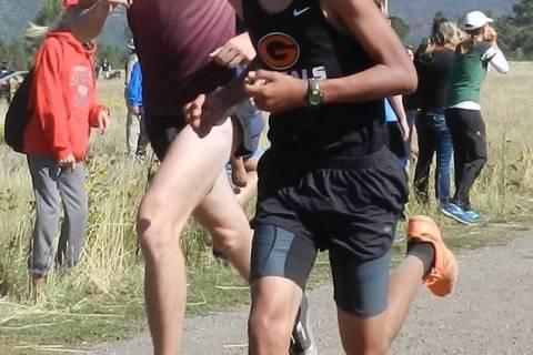 Tammi Odegard/Special to the Pahrump Valley Times Pahrump Valley senior Brandon Ruud, left, run ...