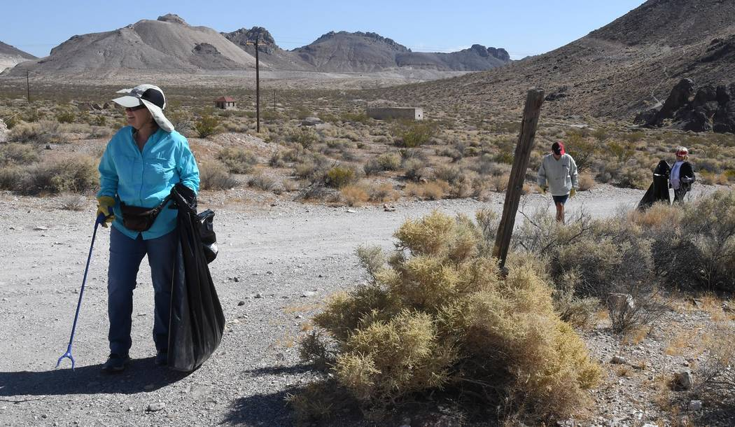 Richard Stephens/Special to the Pahrump Valley Times A volunteer scours the desert for litter i ...
