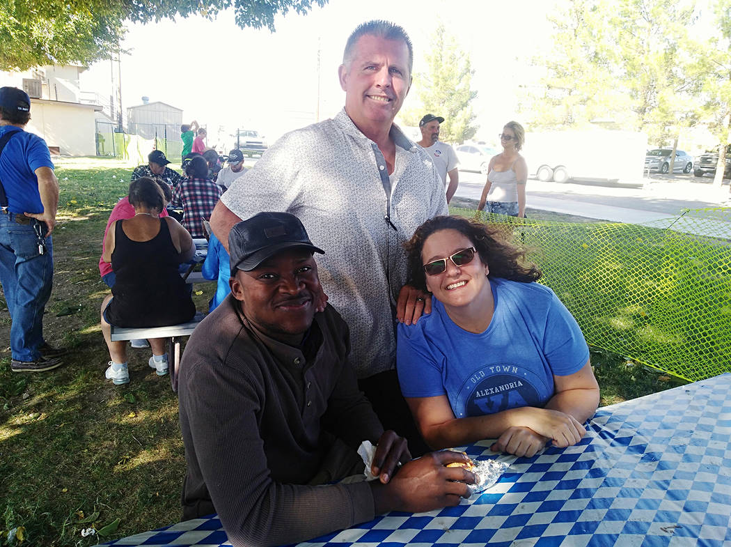 Selwyn Harris/Pahrump Valley Times Local resident Mbaya Mwamba (left), is enjoying lunch with ...
