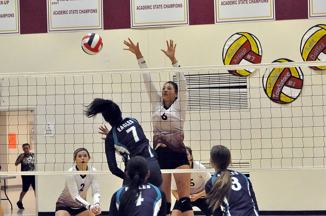 Horace Langford Jr./Pahrump Valley Times Junior Nicky Velazquez blocks an attack by Sky Pointe ...