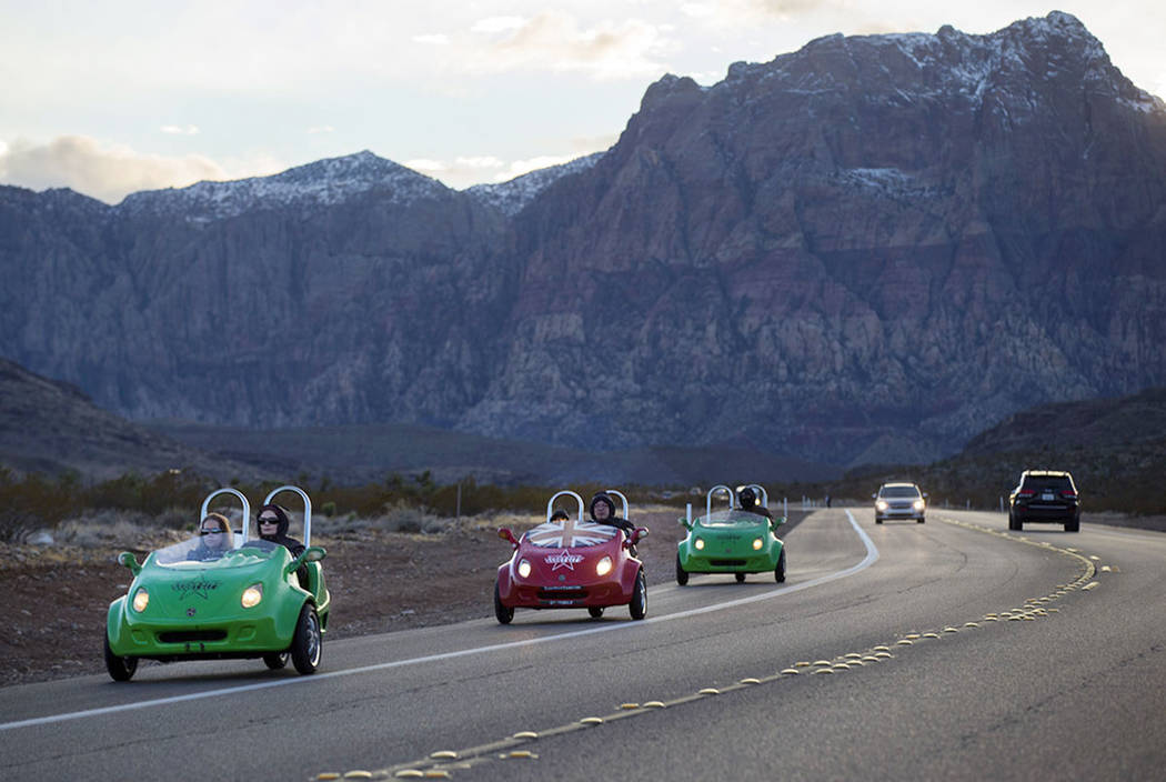 Chase Stevens/Las Vegas Review-Journal Scooter cars pass through the Red Rock Canyon National C ...