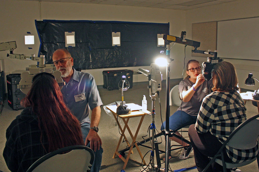 Robin Hebrock/Pahrump Valley Times Pahrump area optometrist Dr. Robert Dutton and his assistant ...