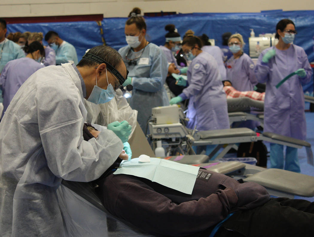Robin Hebrock/Pahrump Valley Times Free filings, teeth extractions and cleanings were offered a ...