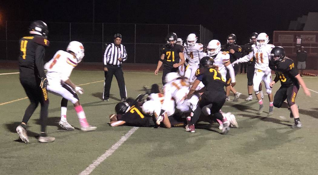 Tom Rysinski/Pahrump Valley Times Pahrump Valley junior Dylan Wright (7) finds the end zone for ...