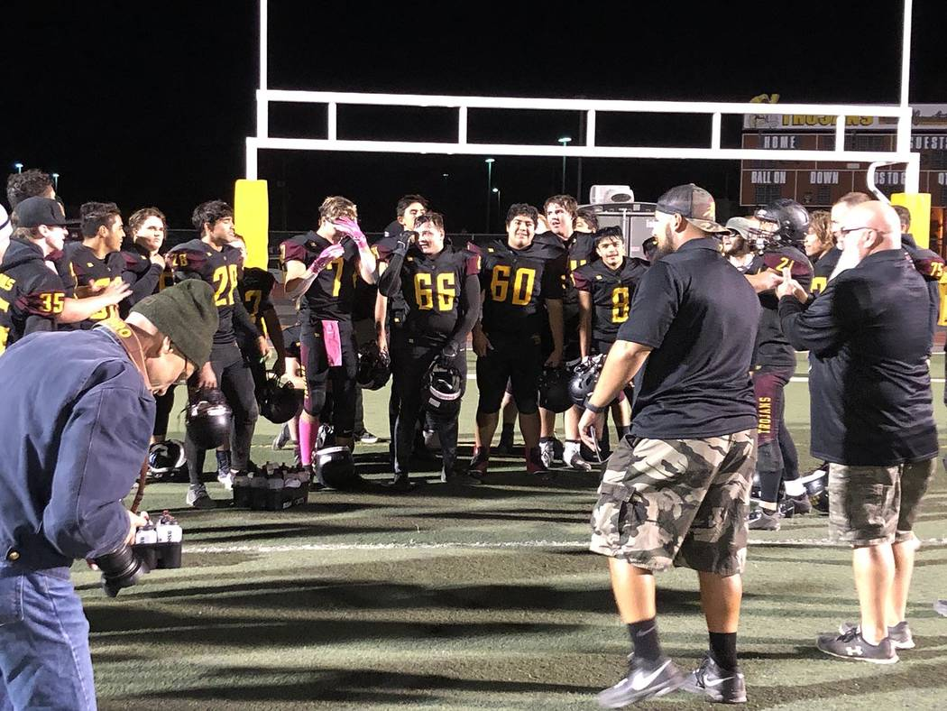 Tom Rysinski/Pahrump Valley Times Pahrump Valley High School football players gather in the end ...