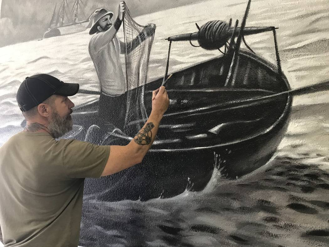 Jeffrey Meehan/Pahrump Valley Times Jerry Ragg, owner and artist at Mural Decor, paints one of ...