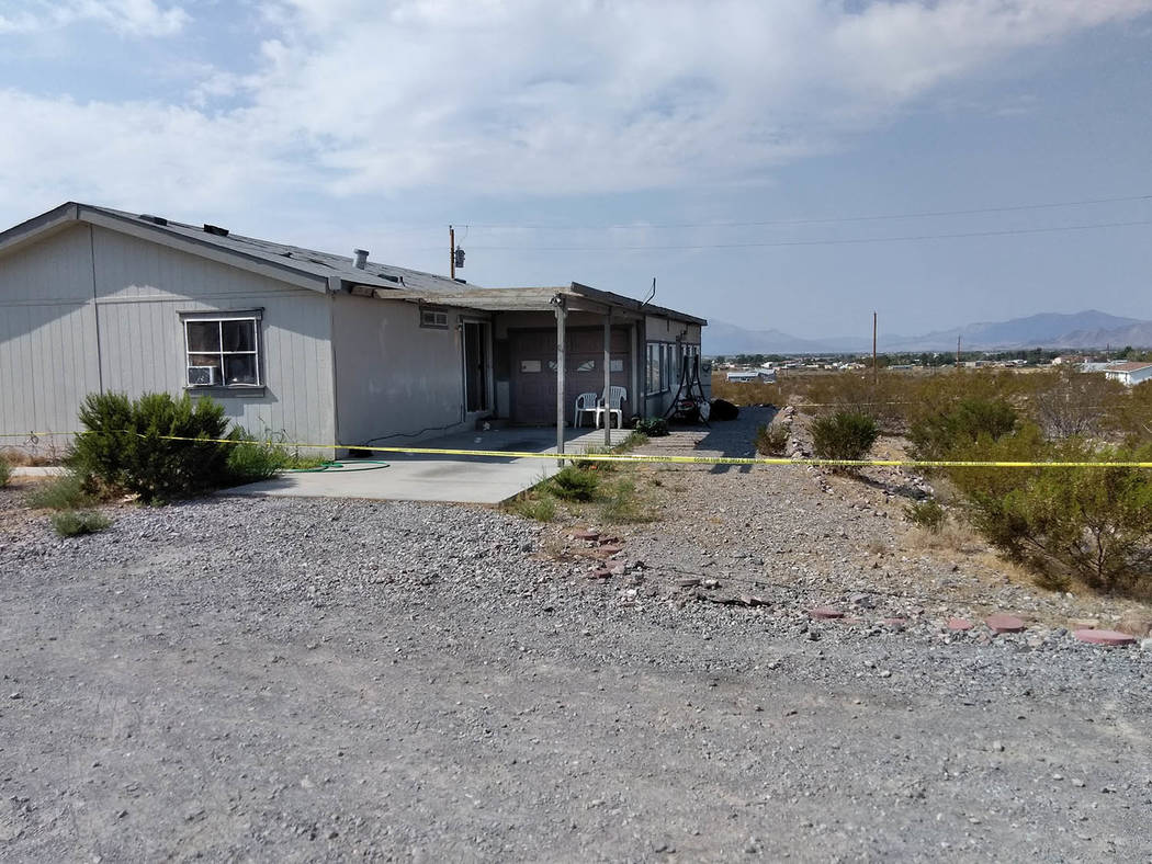 Selwyn Harris/Pahrump Valley Times Yellow crime scene tape surrounds the property where authori ...