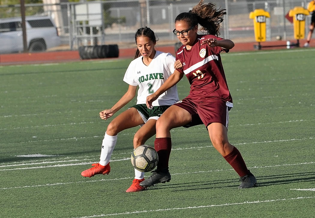 Horace Langford Jr./Pahrump Valley Times Pahrump Valley freshman Leila Denton, right, keeps the ...