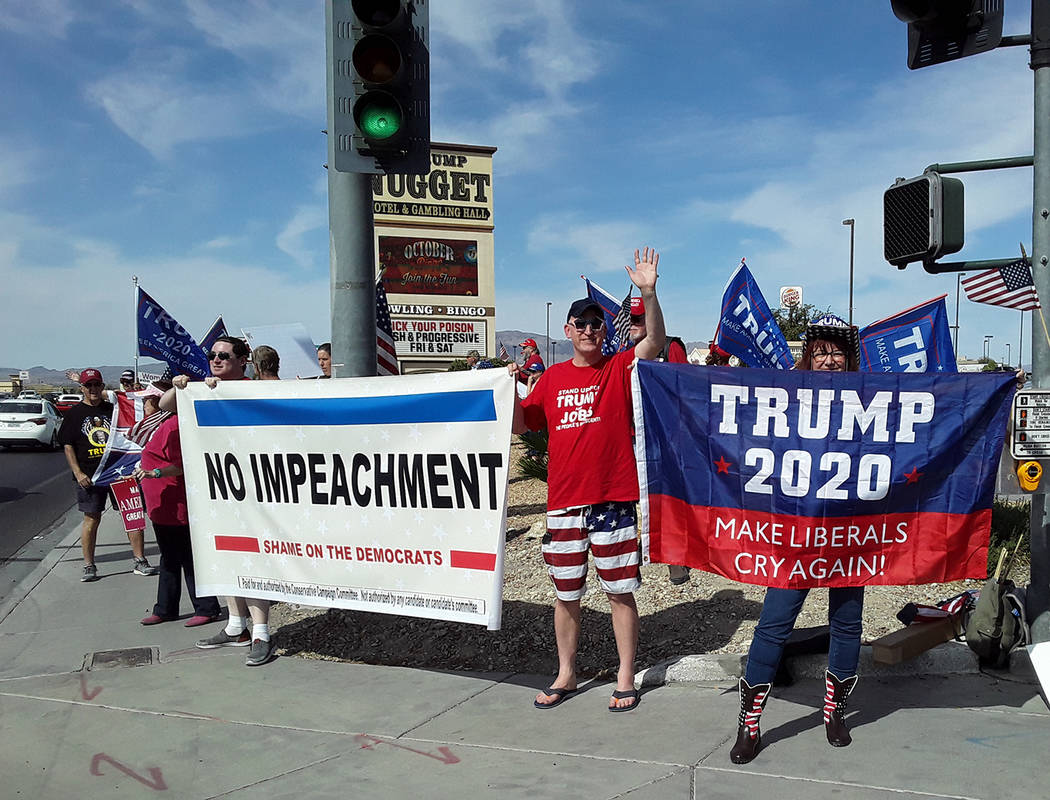 Selwyn Harris/Pahrump Valley Times Several dozen supporters of President Trump gathered at the ...