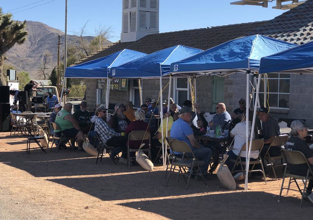 Tom Rysinski/Pahrump Valley Times Participants in the Poker Run relax after completing the cour ...