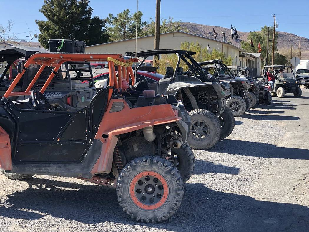 Tom Rysinski/Pahrump Valley Times Vehicles show the wear and tear of 50 miles of off-road drivi ...