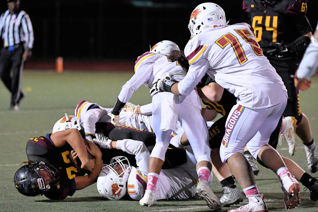 Peter Davis/Special to the Pahrump Valley Times Kenny Delker, shown getting tackled by several ...