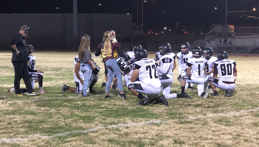Tom Rysinski/Pahrump Valley Times Pahrump Valley High School football players take a knee while ...