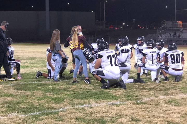 Tom Rysinski/Pahrump Valley Times Pahrump Valley High School football players take a knee while ...