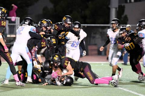 Peter Davis/Special to the Pahrump Valley Times A Western player is stopped after a short gain ...