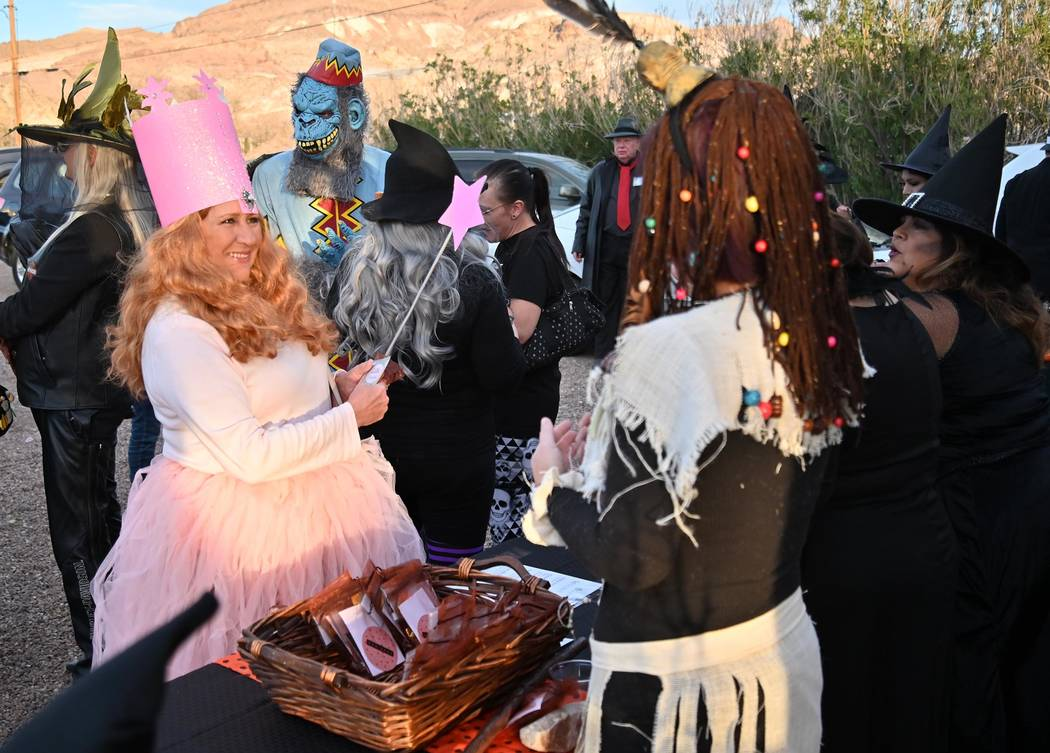 "Richard Stephens/Special to the Pahrump Valley Times A ""good witch"" signs in at the table where ..."